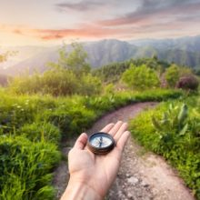 bigstock-Compass-In-The-Mountains-94227551