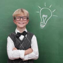Schoolboy at the Blackboard with Idea